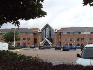 Photograph of the the front building of Asda house.